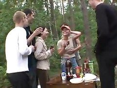5 men and 2 teenager women in the forest