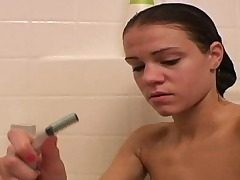 Cute Ally taking shower and shaving