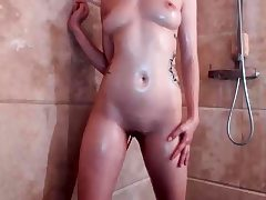 Teen having a douche and shaving in a solo movie