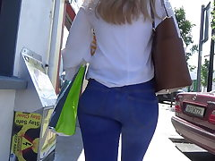 Candid blonde teen in skin taut denim