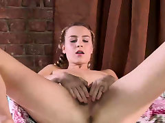 Blonde nubile with pigtails Rita Mochalkina fondles hairy pussy