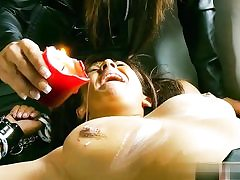 Steamy hoe in leather costume abusing a nude duo cascading wax on their pricks